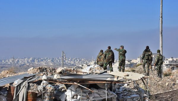 Syrian pro-government forces patrol Aleppo's Sheikh Saeed district, on December 12, 2016, after troops retook the area from rebel fighters - Sputnik International