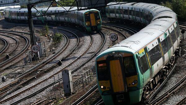 Southern Rail passenger trains arrive at Victoria Station in London on September 7, 2016 - Sputnik International