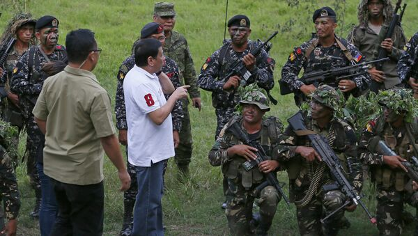 Philippine President Rodrigo Duterte talks to the Philippine Army Scout Rangers at their headquarters at Camp Tecson in San Miguel township, north of Manila, Philippines Thursday, Sept. 15, 2016 - Sputnik International