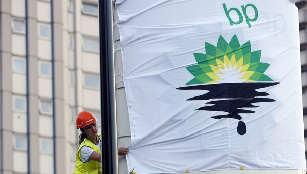 In this Tuesday, July 27, 2010, file photo, a Greenpeace activist puts up a banner as they block off a British Petroleum fuel station in protest as the BP board announce their annual results, in London - Sputnik International