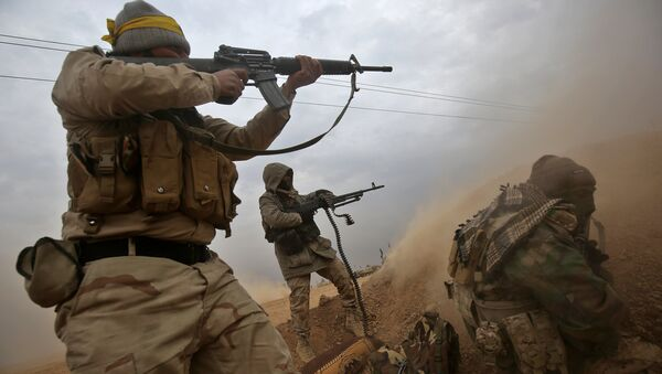 Iraqi Shiite fighters from the Hashed al-Shaabi (Popular Mobilisation) paramilitaries fire their weapons as they advance near the town of Tal Abtah, south of Tal Afar, on November 30, 2016 - Sputnik International