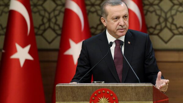 Turkish President Erdogan makes a speech during his meeting with mukhtars at the Presidential Palace in Ankara - Sputnik International
