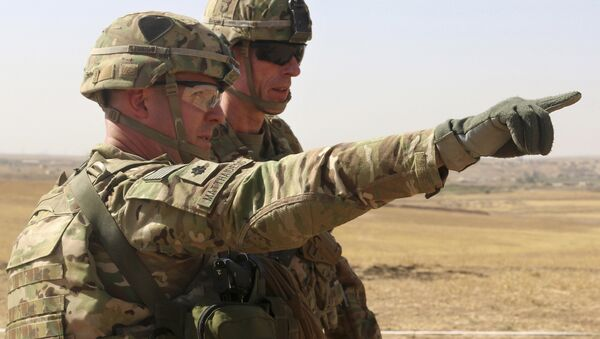 This Oct. 10, 2016 photo released by the U.S. Army shows U.S. Army Lt. Col. Ed Matthaidess, commander, left, Task Force Falcon, outlining areas of an Iraqi security forces tactical assembly area to U.S. Army Maj. Gen. Gary J. Volesky, commander, Combined Joint Forces Land Component Command – Operation Inherent Resolve, in northern Iraq - Sputnik International