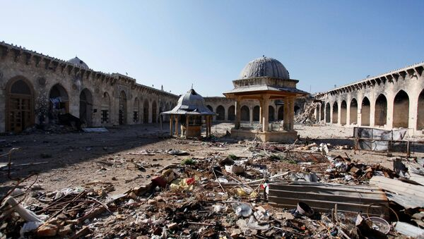 A general view of damage in the Umayyad mosque of Old Aleppo - Sputnik International