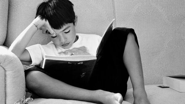 A child reading a book - Sputnik International
