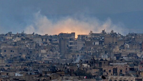 A general view shows smoke and flames rising from buildings in Aleppo's southeastern al-Zabdiya neighbourhood following government strikes on December 14, 2016. - Sputnik International