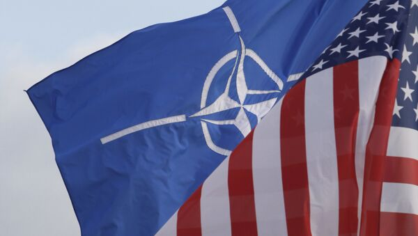 NATO and US flags wave in the wind outside NATO headquarters in Brussels. (File) - Sputnik International