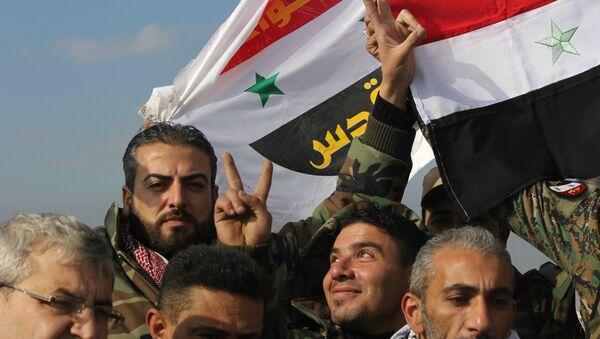 Syrian Arab Army celebrating victory in Sheikh Saeed, East Aleppo. - Sputnik International