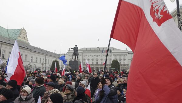 Protesters attend an anti-government demonstration, in Warsaw, Poland - Sputnik International