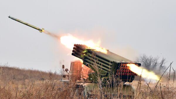 Ukrainian 122 mm MLRS BM-21 Grad fires rocket during a military exercise at a shooting range close to Devichiki in the Kiev region on October 28, 2016 - Sputnik International