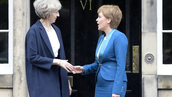 Britain's Prime Minister Theresa May (L) is greeted by Scotland's First Minister Nicola Sturgeon (R) as she arrives for talks at Bute House, in Edinburgh, on July 15, 2016. - Sputnik International