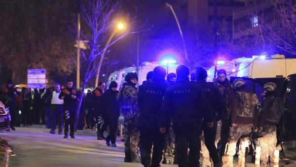 Turkish police officers secure the area close to a photo gallery where the Russian Ambassador to Turkey, Andrei Karlov, was shot by a gunman in Ankara, Turkey. - Sputnik International