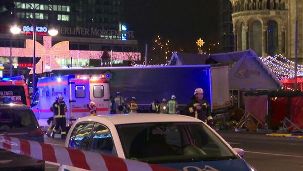 Emergency services attend the scene, after an attack by a truck at a Christmas market, in Berlin. - Sputnik International