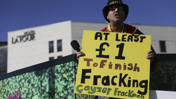 Anti-fracking (hydrolic fracturing) campaigner Gayzer Frackman is seen with a placard in Birmingham, central England, on October 2, 2016 on the first day of the Conservative party annual conference being held at Birmingham's International Convention Centre - Sputnik International