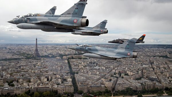 FILE PHOTO - Four Mirage 2000C and one Alpha jet flight over Paris, France, on their way to participate in the Bastille Day military parade, July 14 2016 - Sputnik International