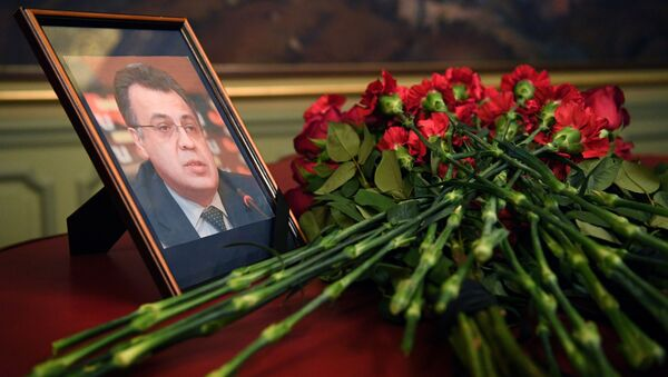 Flowers are placed in front of a portrait of Russian Ambassador to Turkey Andrei Karlov in the Foreign Ministry in Moscow a day after the assassination of the Russian ambassador in the Turkish capital - Sputnik International
