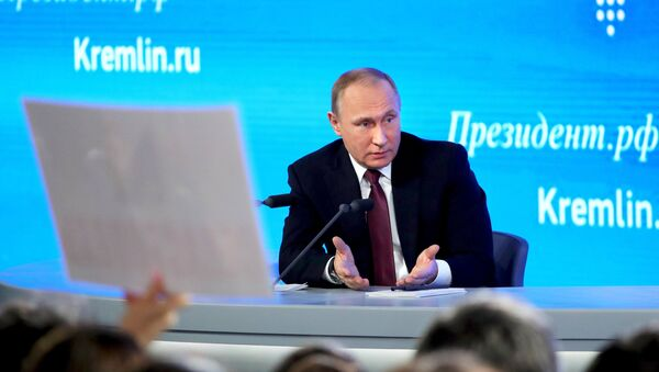 Russian President Vladimir Putin attends his annual end-of-year news conference in Moscow, Russia - Sputnik International