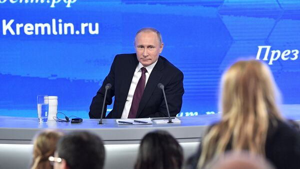 Russian President Vladimir Putin during his 12th annual news conference at Moscow's World Trade Center in Krasnaya Presnya - Sputnik International