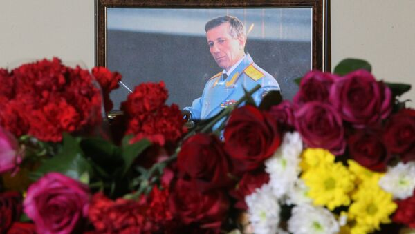 A photo of Russian Army Bandmaster Lieutenant General Valery Khalilov, who died in the Russian Defense Ministry's TU-154 crash, is seen here outside the building of The Alexandrov Academic Ensemble of Song and Dance of the Russian Army in Moscow - Sputnik International