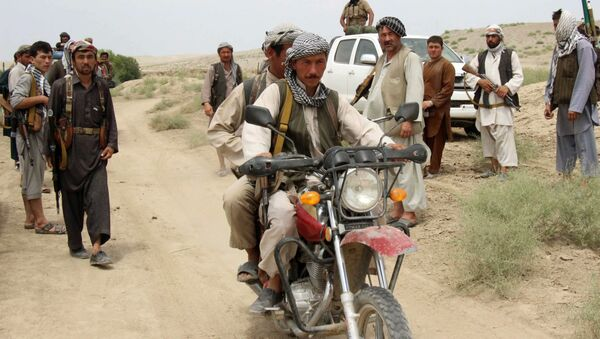 This photograph taken on August 1, 2015, shows members of Afghanistan's militia forces gathering in the Qala-e Zal district of Kunduz province - Sputnik International