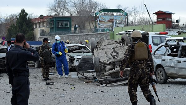 Afghan police and security personnel inspect the scene of a suicide car bomb attack near a district police headquarters in the centre of the Afghan capital Kabul - Sputnik International