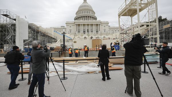 Members of the media document workers on Capitol Hill in Washington, Thursday, Dec. 8, 2016, as construction continues on the Inaugural platform in preparation for the Inauguration and swearing-in ceremonies for President-elect Donald Trump - Sputnik International