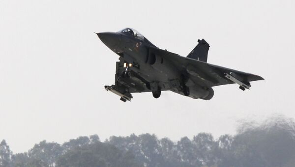 An Indian Light Combat Aircraft (LCA) 'Tejas' flies during an 'Initial Operational Clearance' procedure before induction into The Indian Air Force (IAF) at Hindustan Aeronautical Ltd. (HAL) airport in Bangalore on January 10, 2011 - Sputnik International