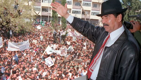A photo released by Iraqi Press Agency 02 April shows President Saddam Hussein waving to supporters during his visit to the town of Kirkuk north of Baghdad. - Sputnik International