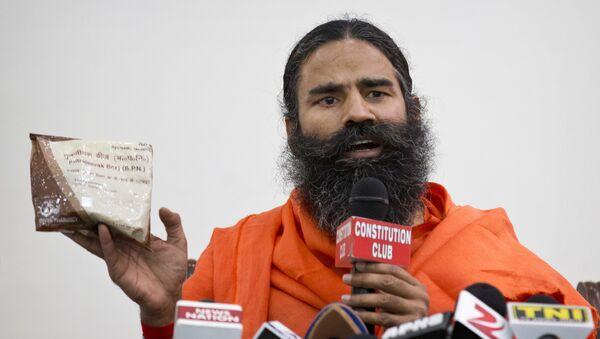 "Indian yoga guru Baba Ramdev displays a packet of Ayurvedic medicine called ""Putrajeevak Beej"", which is produced by Patanjali Ayurveda Kendra, part of a trust established by him in New Delhi, India (File) - Sputnik International"