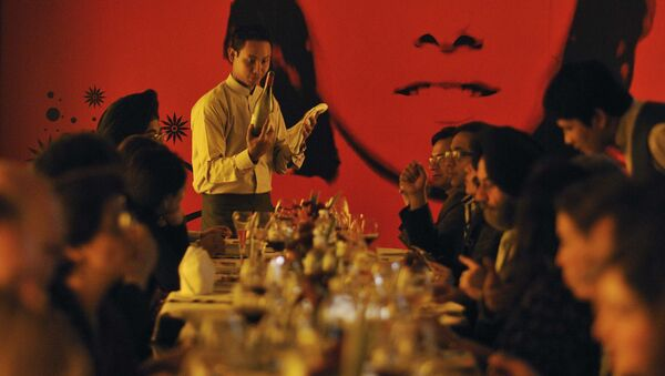 In this Sunday, Jan. 16, 2011 photo, a waiter serves wine to a group learning wine appreciation and fine dining, being conducted by Tulleeho Beverage Innovations at a restaurant in New Delhi, India - Sputnik International