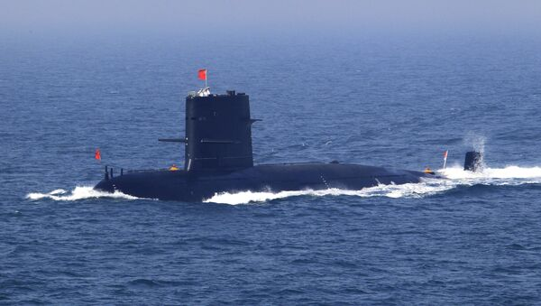 In this April 26, 2012 file photo released by China's Xinhua News Agency, Chinese navy's submarine attends the fleet review of the China-Russia joint naval exercise in the Yellow Sea - Sputnik International