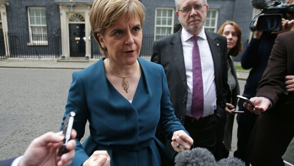 Scottish First Minister Nicola Sturgeon gestures as she speaks to members of the media outside 10 Downing Street in central London on October 24, 2016 after holding talks with British Prime Minister Theresa May and the first ministers of Wales and Northern Ireland on the government's Brexit plans. Sturgeon, leader of the secessionist Scottish National Party, - Sputnik International