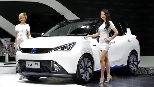 Models pose with the GAC Motors GE3 electric car at the North American International Auto Show in Detroit, Monday, Jan. 9, 2017.  - Sputnik International