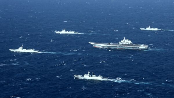 China's Liaoning aircraft carrier with accompanying fleet conducts a drill in an area of South China Sea in this undated photo taken December, 2016 - Sputnik International