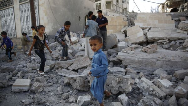 In this Sept. 8, 2015 file photo, children play amid the rubble of a house destroyed by a Saudi-led airstrike in Sanaa, Yemen - Sputnik International
