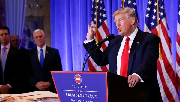Vice President-elect Mike Pence is seen in the background as U.S. President-elect Donald Trump speaks during a press conference in Trump Tower, Manhattan, New York, U.S., January 11, 2017 - Sputnik International