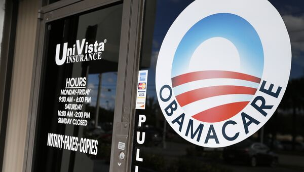 An Obamacare logo is shown on the door of the UniVista Insurance agency in Miami, Florida on January 10, 2017 - Sputnik International