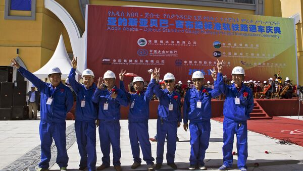 Chinese workers pose at the inauguration site of a train linking Addis Ababa to Djibouti, 20 kilometres from the centre of Addis Ababa on October 5, 2016 - Sputnik International