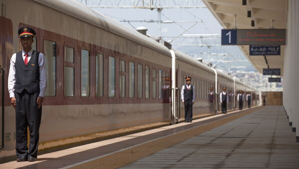 Chinese employees of the Addis Ababa / Djibouti train line stand at the Feri train station in Addis Ababa on September 24, 2016. With Chinese conductors at the helm, a fleet of shiny new trains will on October 5, 2016 begin plying a new route from the Ethiopian capital to Djibouti, in a major boost to both economies - Sputnik International