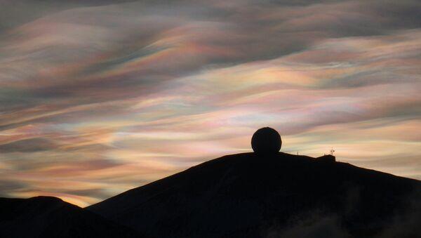 Nacreous Clouds over the NASA Radome, McMurdo Station, Antarctica - Sputnik International
