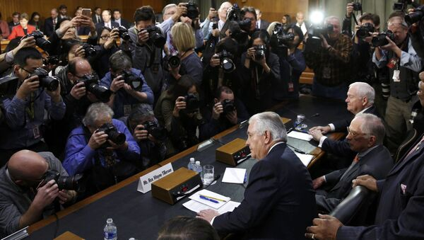 Rex Tillerson (C), former chairman and chief executive officer of Exxon Mobil, is seated prior to testifying before a Senate Foreign Relations Committee confirmation hearing on his nomination to be U.S. secretary of state, on Capitol Hill in Washington, U.S. January 11, 2017 - Sputnik International