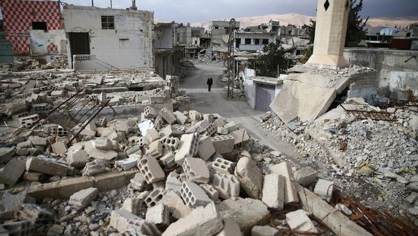 A man walks past damaged buildings in the rebel held besieged city of Douma, in the eastern Damascus suburb of Ghouta, Syria January 8, 2017 - Sputnik International