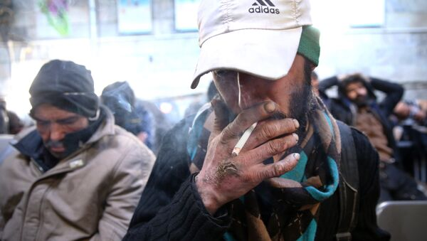 In this Tuesday, Feb. 3, 2015 photo, a drug addict smokes cigarette at drop-in center and shelter south of Tehran, Iran - Sputnik International
