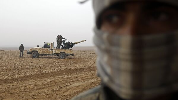 Fighters from the Kurdish-Arab alliance, known as the Syrian Democratic Forces, are seen near the village of Khirbet al-Jahshe, some 35 kilometres from al-Tabaqah on the western outskirts of Raqa as they advance towards the Islamic State (IS) group bastion on December 13, 2016 - Sputnik International