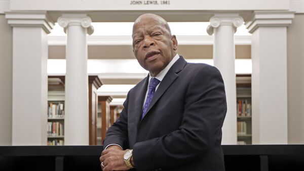 Rep. John Lewis, D-Ga., poses for a photograph under a quote of his that is displayed in the Civil Rights Room in the Nashville Public Library Friday, Nov. 18, 2016, in Nashville, Tenn.  - Sputnik International