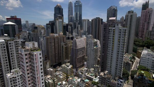 The Sheung Wan neighbourhood (bottom) on Hong Kong island is seen from a residential building with the skyscrapers of the central business district behind. (File) - Sputnik International