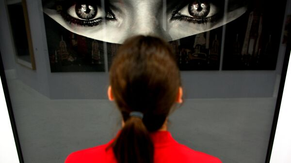 A woman looks at the work Burka by US artist Robert Longo at the booth of the gallery Hans Mayer on April 12, 2011 at the Art Cologne art fair in Cologne, western Germany. Around 200 international galleries will be showcasing Classic Modernism, Post-War and Contemporary art during the fair running until April 17, 2011.  - Sputnik International