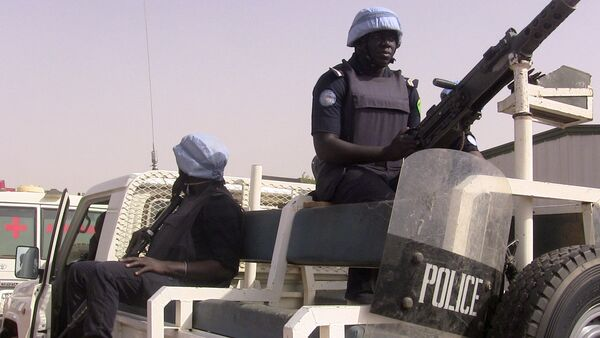 Malian police patrol with German UN mission in Mali (MINUSMA) peacekeping forces on May 18, 2016 in Gao, northern mali - Sputnik International