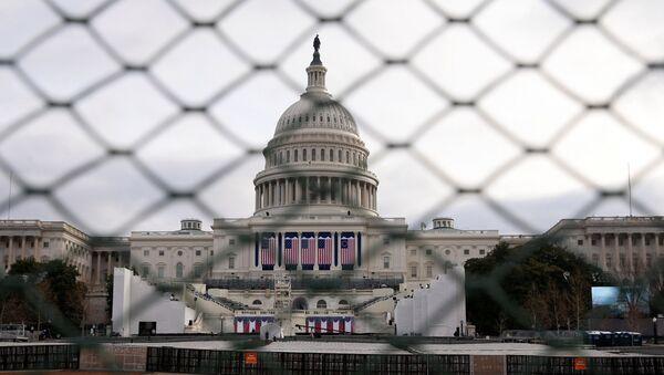 The U.S. Capitol building is seen behind a security fence in Washington, U.S., January 19, 2017 - Sputnik International