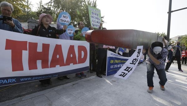Protesters carry a mock missile symbolizing an advanced U.S. missile defense system called Terminal High-Altitude Area Defense, or THAAD, during a rally to oppose a plan to deploy the THAAD in front of the Defense Ministry in Seoul, South Korea, Thursday, Oct. 20, 2016 - Sputnik International